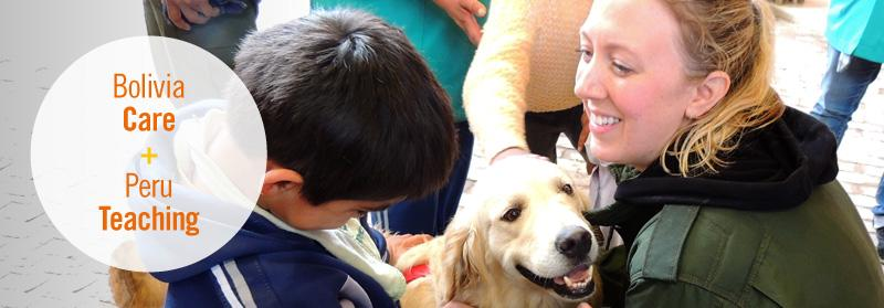 Female volunteer working with child and dog at canine therapy project, Bolivia