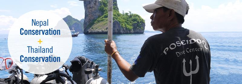 Projects Abroad conservation volunteers and staff head to a dive site off the coast of Krabi, Thailand, to conduct fish surveys