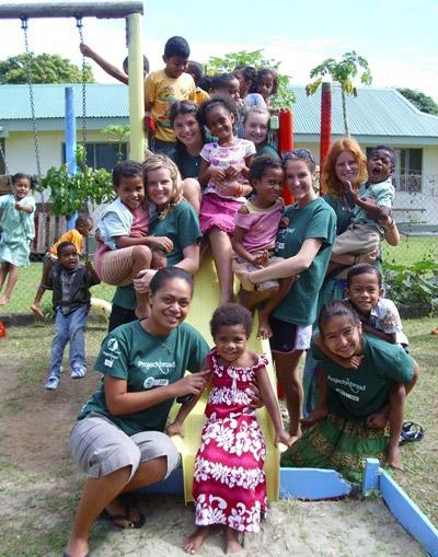 A group of Projects Abroad volunteers and children in Fiji