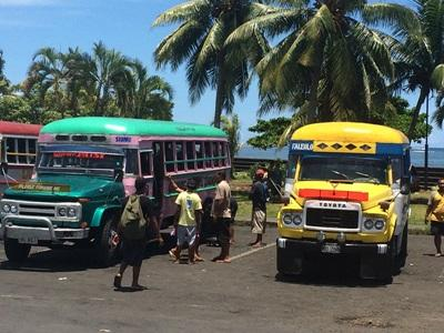 Volunteers board local buses in preparation for an outing