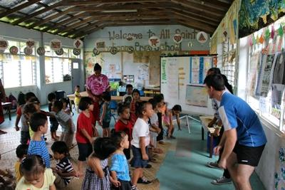 Projects Abroad Samoa volunteers run games for small children at their school sports placement