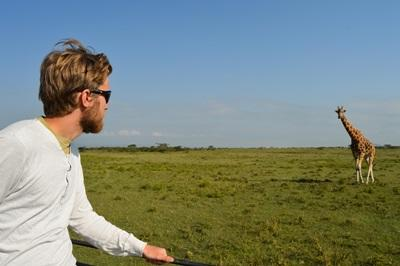 A Norwegian Projects Abroad volunteer looks at a Rothschild giraffe at the Soysambu conservancy in Nakuru, Kenya