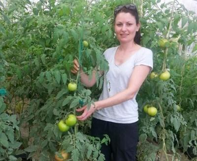 A Projects Abroad volunteer on a Community Farming project stands at her placement in Jamaica