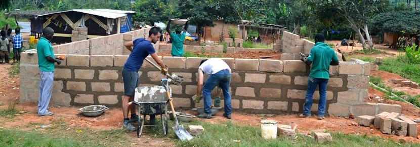 Projects Abroad volunteers building houses overseas