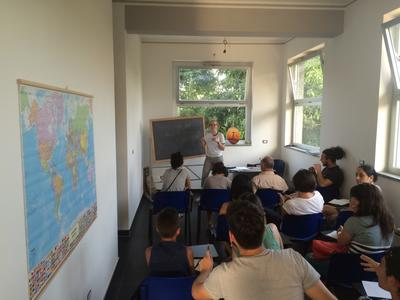 Volunteers in a class during their Refugee project