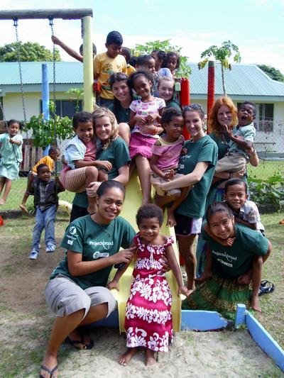 A group of Projects Abroad Care volunteers pose with children in Fiji