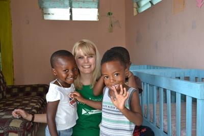 Projects Abroad Care volunteer poses with young children at her placement in Jamaica; the Hill Crest Day Care Centre.