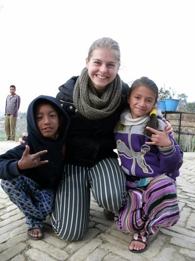 Volunteer with children at her Care placement in Nepal