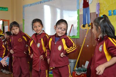 Young girls dance to traditional Peruvian music at the Projects Abroad Care placement in Peru