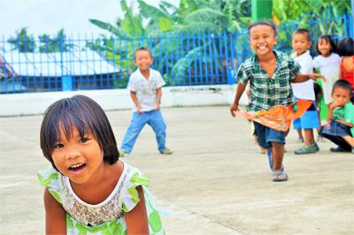 Local Filipino children play at Projects Abroad Care placement in Philippines, Asia