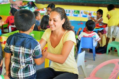 Projects Abroad volunteers do arts and crafts with children at Care placement in Philippines, Asia