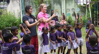 Projects Abroad High School Care and Community volunteers play games with children at a pre-school in Colombo