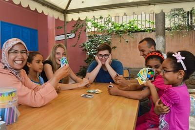 Projects Abroad volunteers playing with children at a Care placement overseas in Morocco