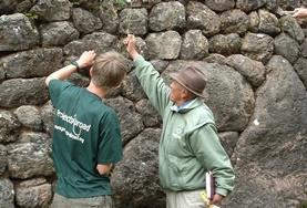 An Archaeology volunteer work with an archaeologist on an Inca & Wari dig site during her internship in Peru.