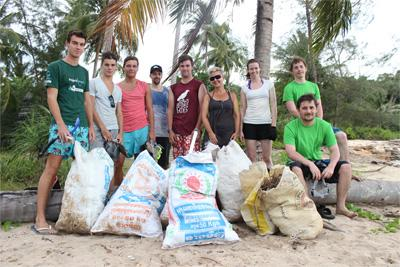 Group photo of Projects Abroad conservation volunteers after collecting rubbish from paradise beach in Cambodia
