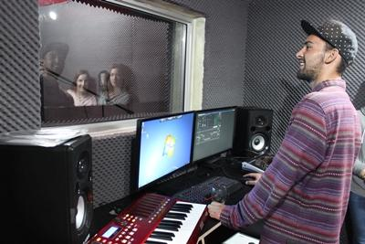 A volunteer records vocals during a music production internship at his placement in Cape Town, South Africa