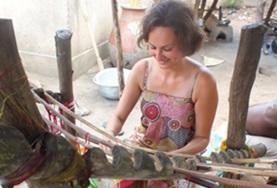 An Arts & Crafts volunteer learns how to weave using a traditional loom at her placement in Togo.