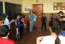A Drama volunteer provides guidance and coaching to a local school children in Romania.