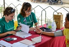 Public Health volunteers takes measurements like blood pressure and blood sugar levels during a medical outreach in the Philippines.