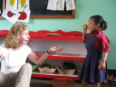 A child plays with a Projects Abroad volunteer at her school in Nepal.
