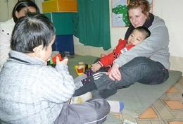 High School Project volunteers work with disabled children in Vietnam.