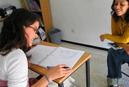 A high school student receives one-on-one tutoring during her volunteer Care and Arabic language project in Morocco.