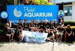 A group of High School Project volunteers prepare for a survey dive as part of their marine conservation work in Thailand.