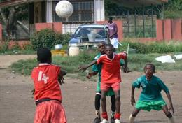 Children in Ghana playing soccer at our volunteer Sports placement for high school students.