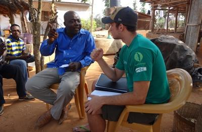 Projects Abroad volunteer in discussion with a local farm owner in Togo
