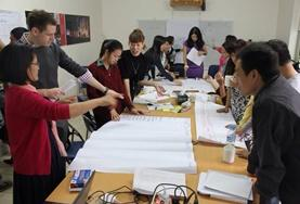 International Development volunteers discuss a fundraising event with staff from a local NGO in Vietnam.