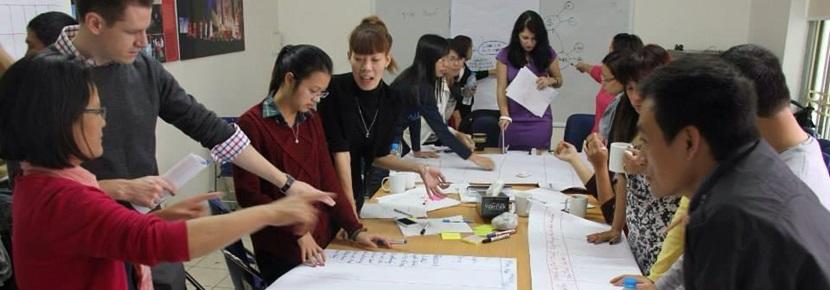 Projects Abroad Vietnam volunteers plan for their project around a table
