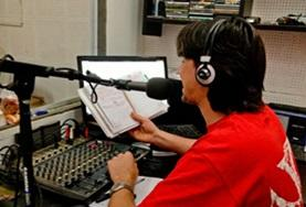 A Journalism intern observes as a radio DJ demostrates the basics of radio journalism in Argentina.