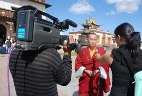 A Journalism intern interviews a local person for a news station in Mongolia, Asia.