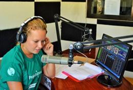 A Journalism intern makes a recording for a local radio station during her internship in the Philippines.
