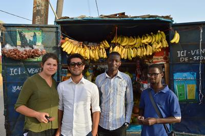 A group of Projects Abroad volunteers and locals pose for a picture