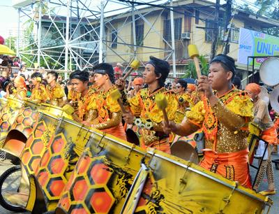 Local Filipinos perform traditional songs and dances at the Sinulog festival in the Philippines