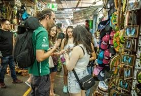 Volunteers practise their Spanish language skills while speaking to local vendors at a market in Costa Rica.
