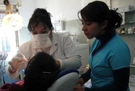 Argentina A volunteer observes as a local dentist examines a patient at our  Dentistry internship placement in