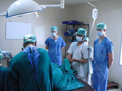 A Group of Projects Abroad Medicine volunteers observe an operation in Bangladesh