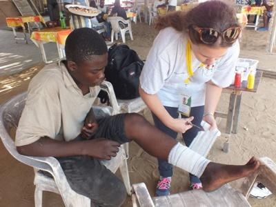Projects Abroad Medicine volunteer helping a local at a community outreach project in Togo