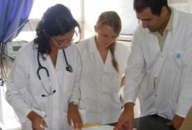 A local doctor speaks to Medicine interns about a patient's file during their Medical internship in Morocco.