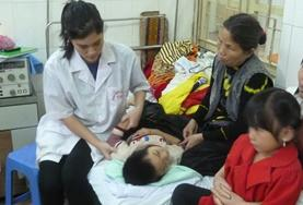 Medical interns in Vietnam help with caring for a patient in a local hospital.
