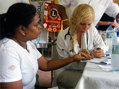 Female volunteer working in a medical project in Sri Lanka, Asia