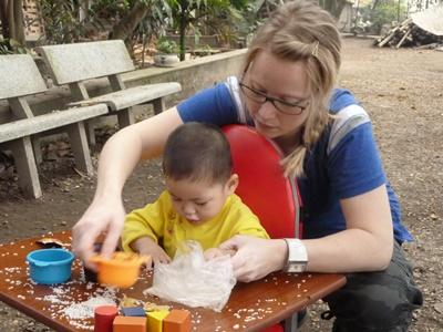 Projects Abroad Vietnam volunteer works with children at physiotherapy placement