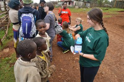 A Projects Abroad Pharmacy volunteer dispenses anti-worm pills to local children in Nanyuki, Kenya