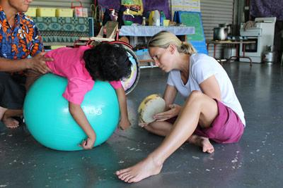 Projects Abroad Physiotherapy volunteer works with child at her placement in Samoa