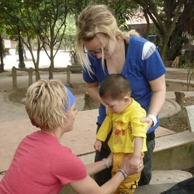 A Projects Abroad physiotherapist treats a child in Vietnam