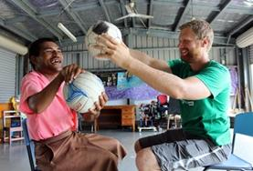 A Physiotherapy intern treats a disabled man in Samoa.