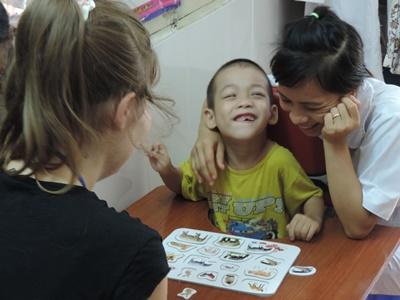 Female volunteers busy in a occupational therapy project in Vietnam, Asia.