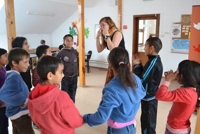 A Projects Abroad social work intern playing games with children in Romania
